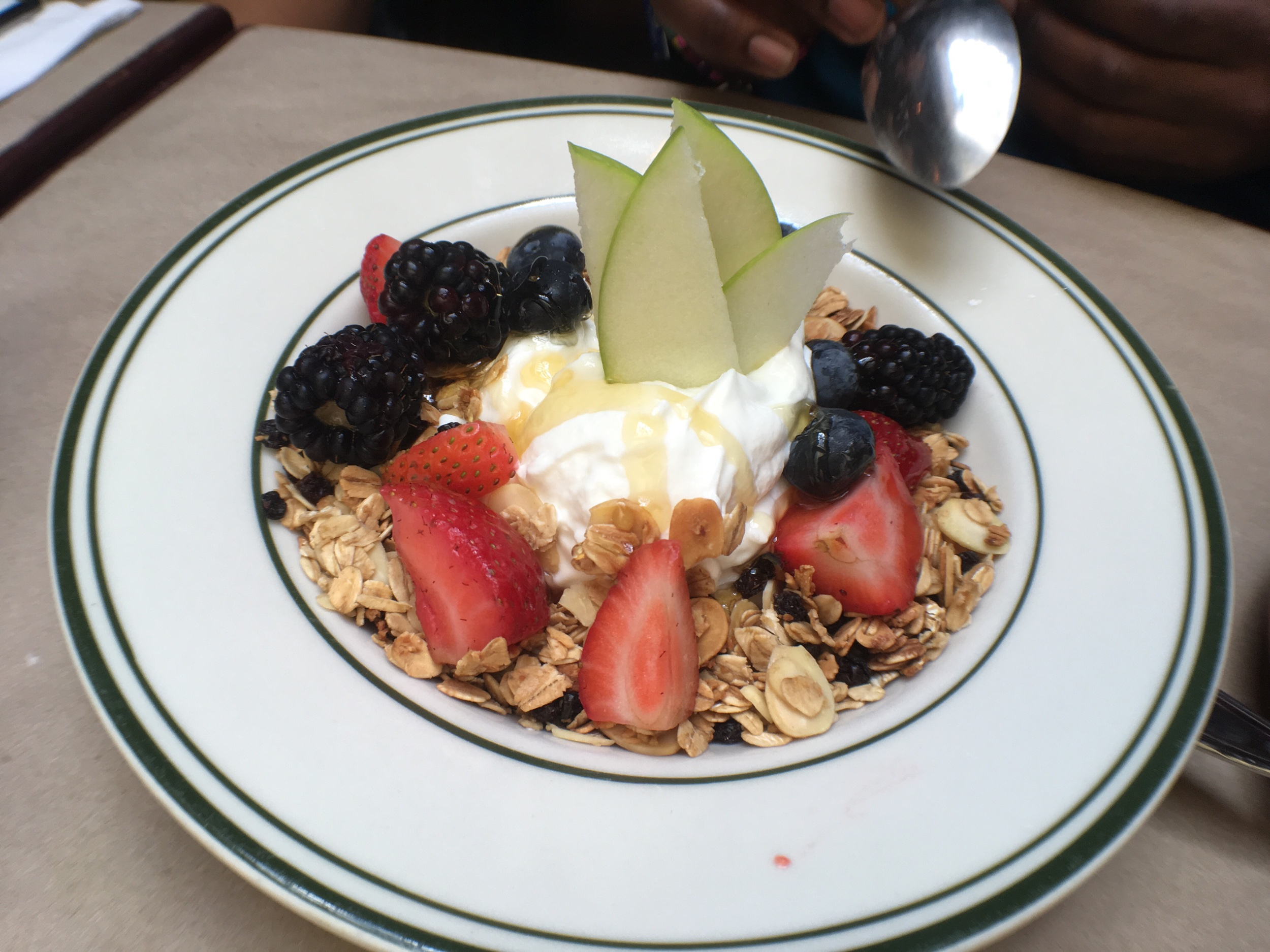 Fruit bowl with granola and yogurt