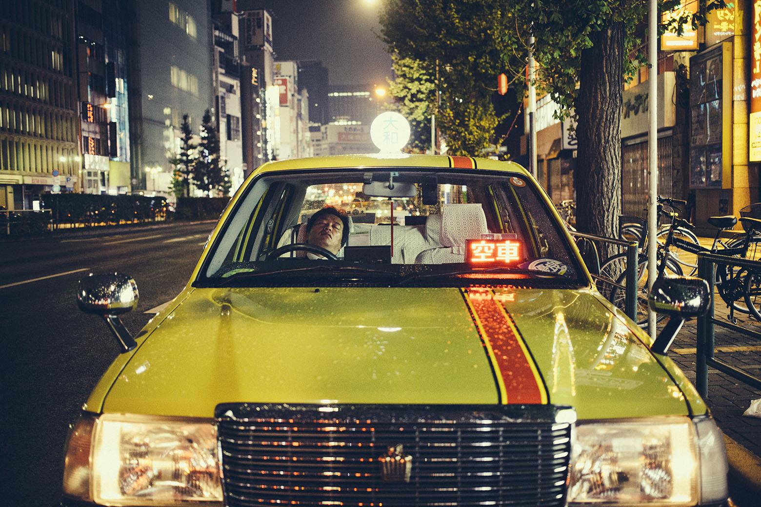 Sleeping taxi driver. Shinjuki, Tokyo. November 2014.