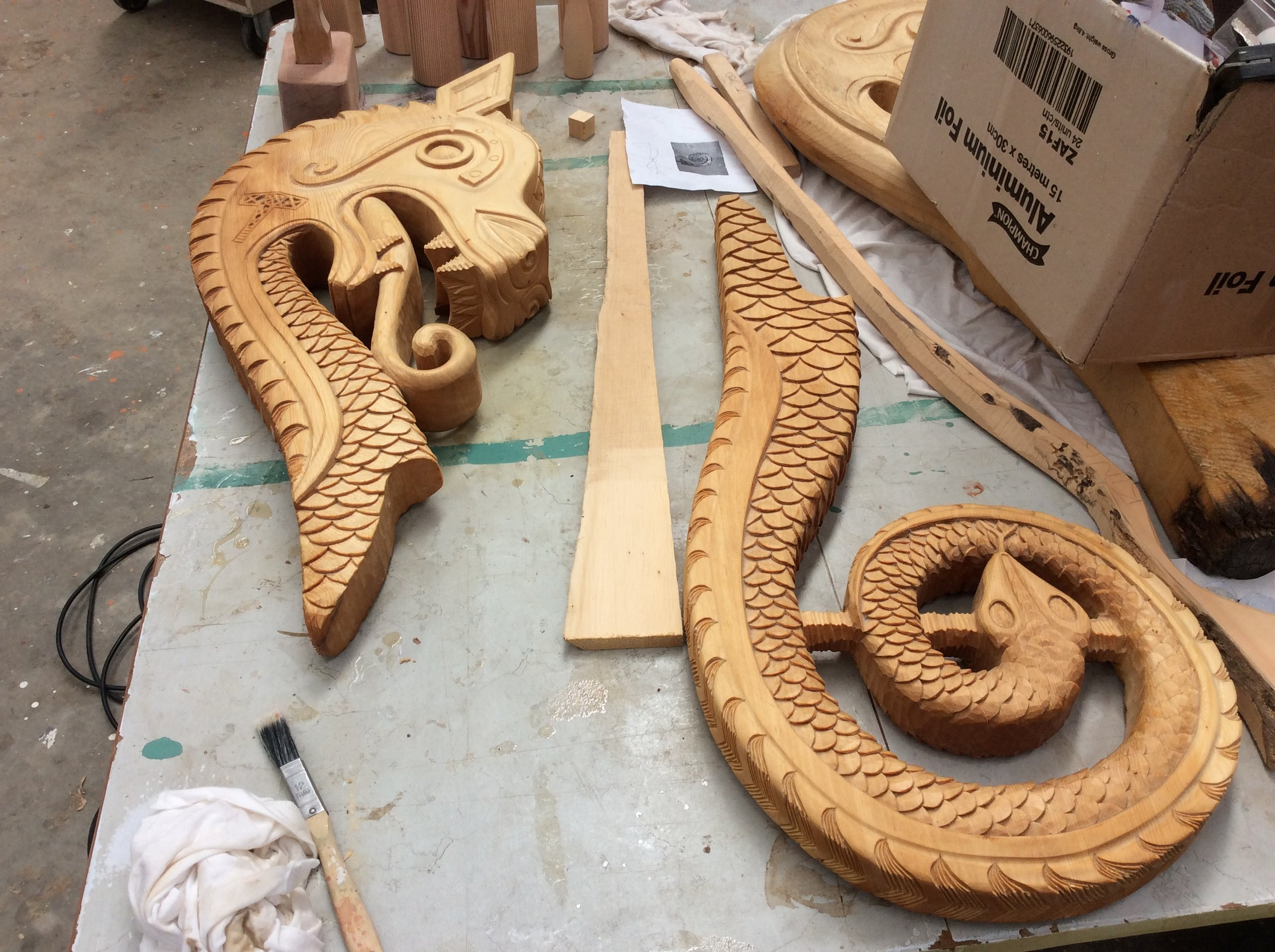 The dragons head and snakes tail fore and aft figureheads for the viking boat