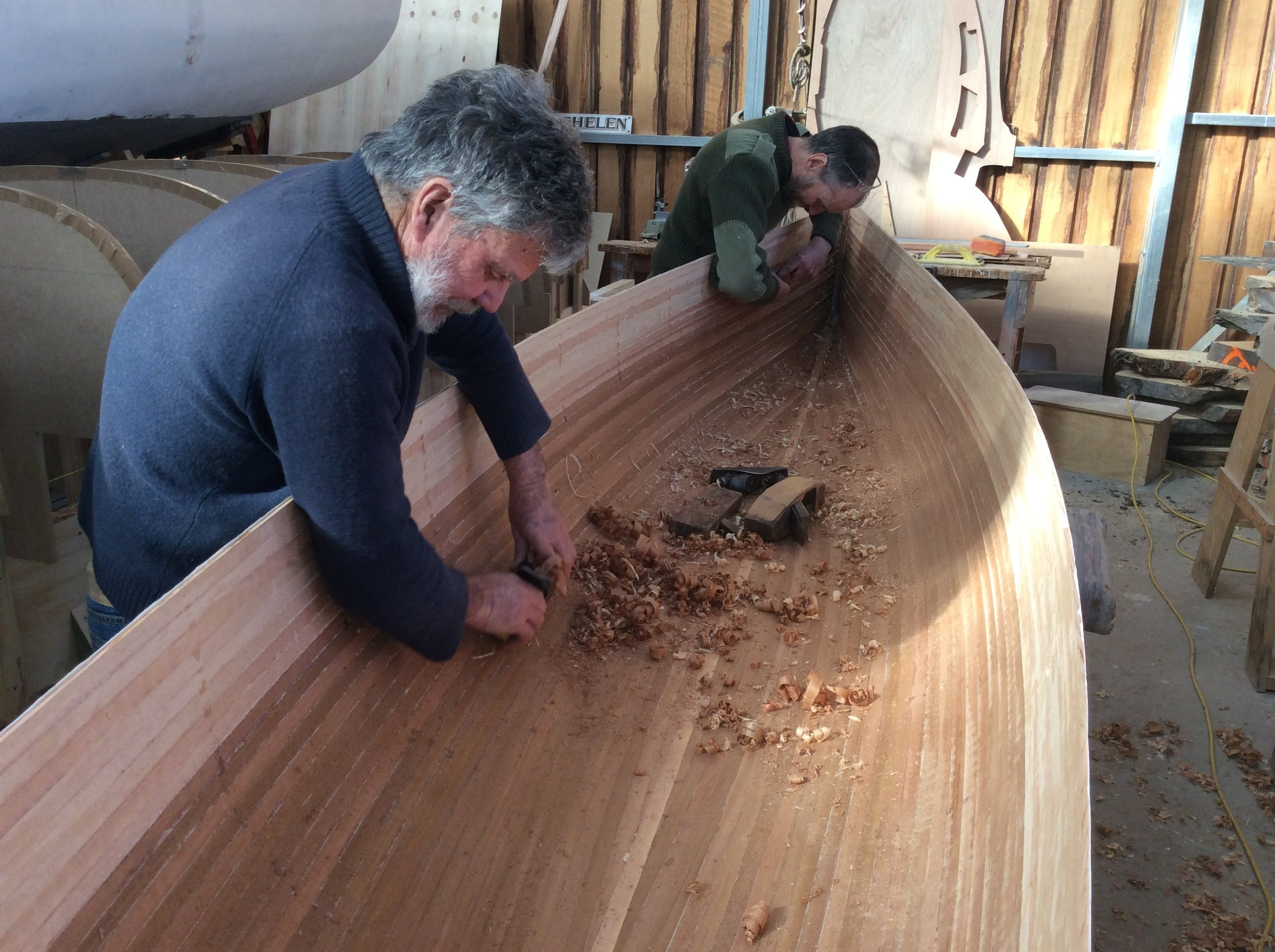 Shipwright Peter Heading with Peter Shimeld working on a strip planked kayak.JPG
