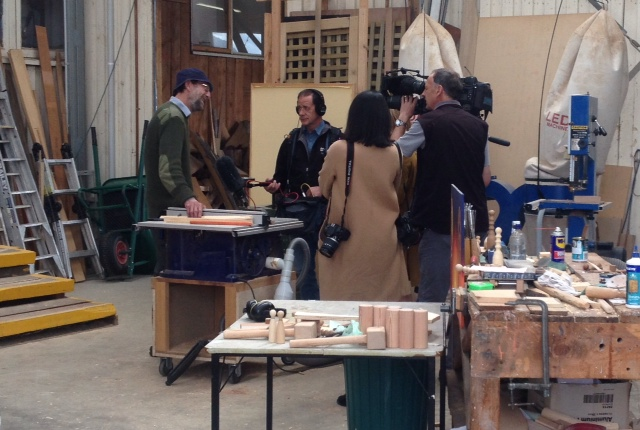 The ABC News film crew interviewing Pete about the construction of the boat.