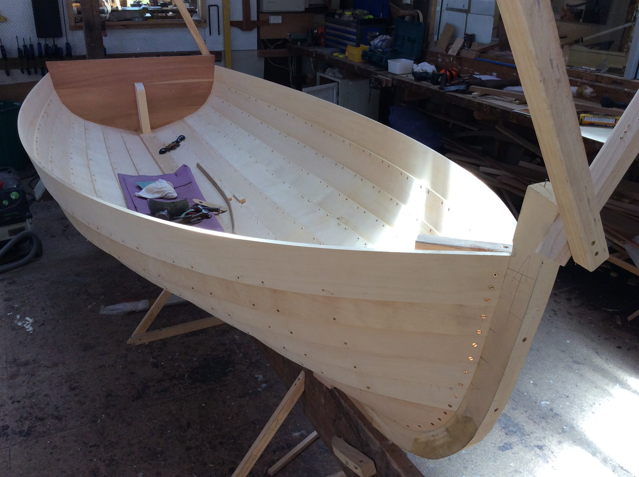 One of Bill Foster's dinghy designs under construction.  This was designed for use by Bill's daughter, as I understand.  This is being built by Mike Johnson with Huon Pine planking and King Billy Pine transom.  The moulds are just out, next stage is to put the ribs in.