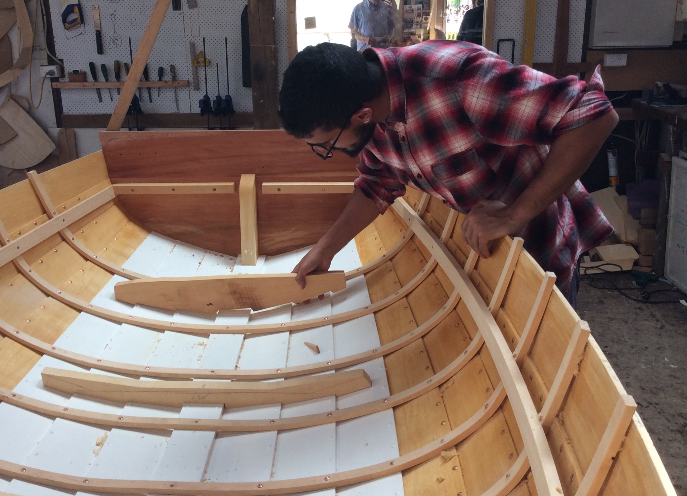 Salvatore' is a design student from Italy.  He has strong wood working skills and was looking to spend some time in the boat shed to learn about traditional wooden design and boatbuilding techniques.  He spent time with Mike Johnson steaming ribs and fabricating timber components on a Foster 10.  He also assisted Pete Laidlaw replacing a plank on the old 18' Couta boat.  He loved his time with us and I'm sure will replicate some of these skills when he establishes his planned design collective business back home.    We regularly offer short stints of time to people wishing to experience the boat shed work environment or to those wishing to acquire a particular bunch of skills.