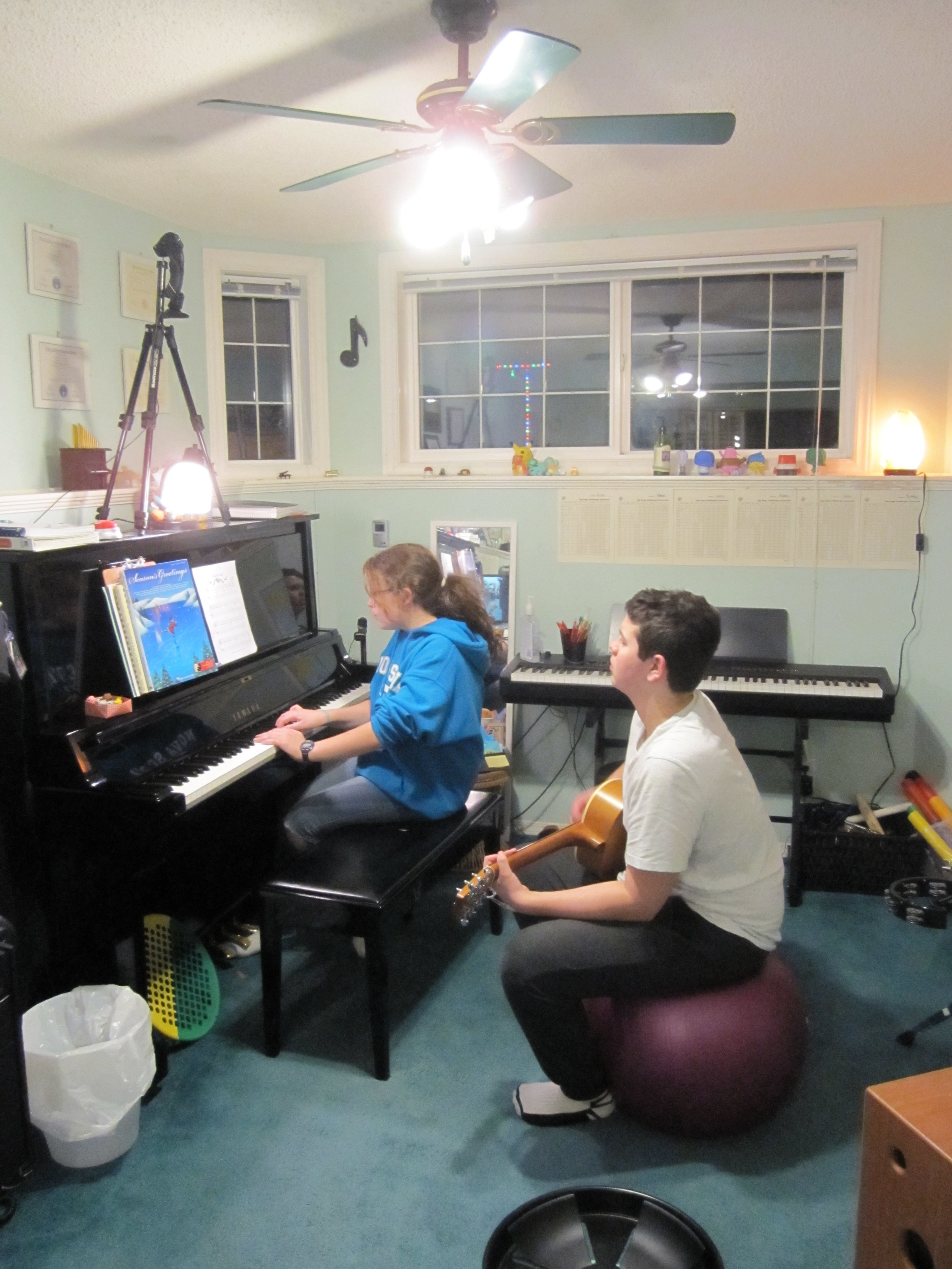Haley and Grayson brainstorming on ways to vary their Christmas music. Photo credit: Rhona-Mae Arca.