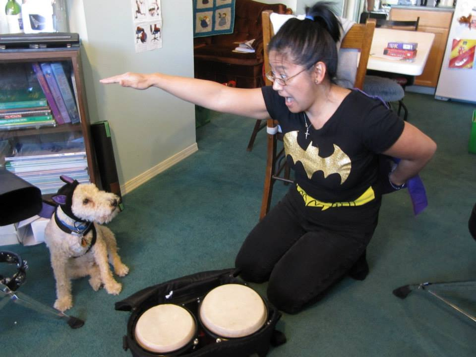 Batdog and Batgirl prepare for the Halloween Piano Party. Photo: C. Kohl.