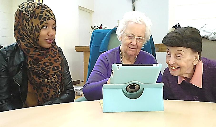 Participants enjoying touchscreen activities on an apple ipad