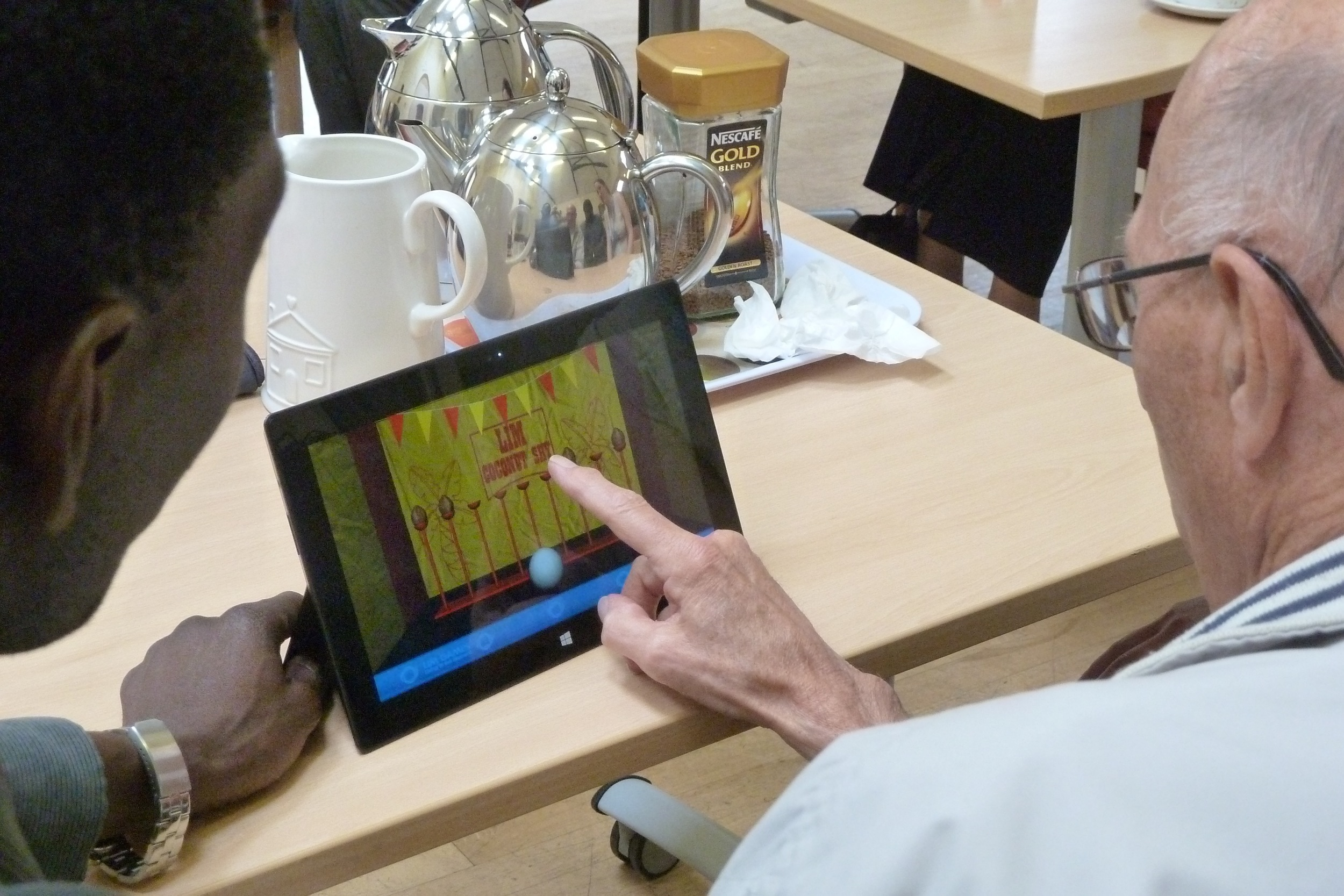 Participants engaging with touchscreen activities (3)
