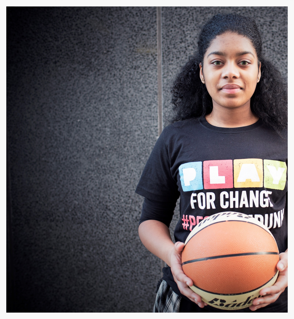Young female participant on the Play for Change:  Slam Dunk  basketball and inspiration programme.