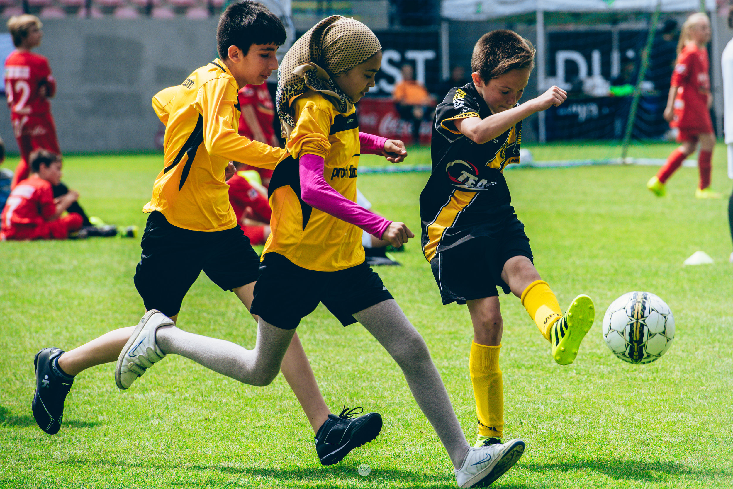 Boys and girls play alongside each other