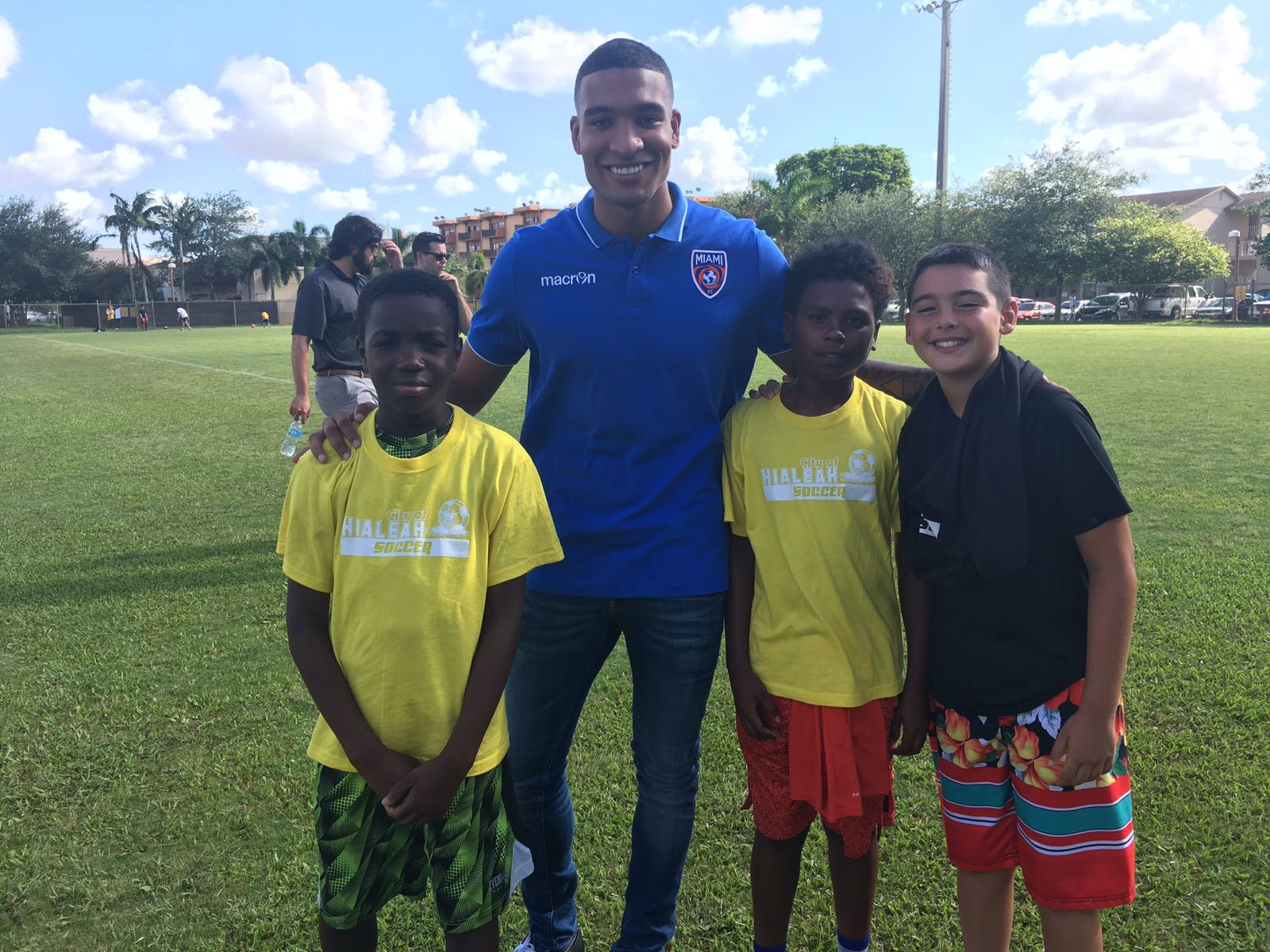 Miami FC player Aaron Dennis pleased to celebrate Kick It with local children