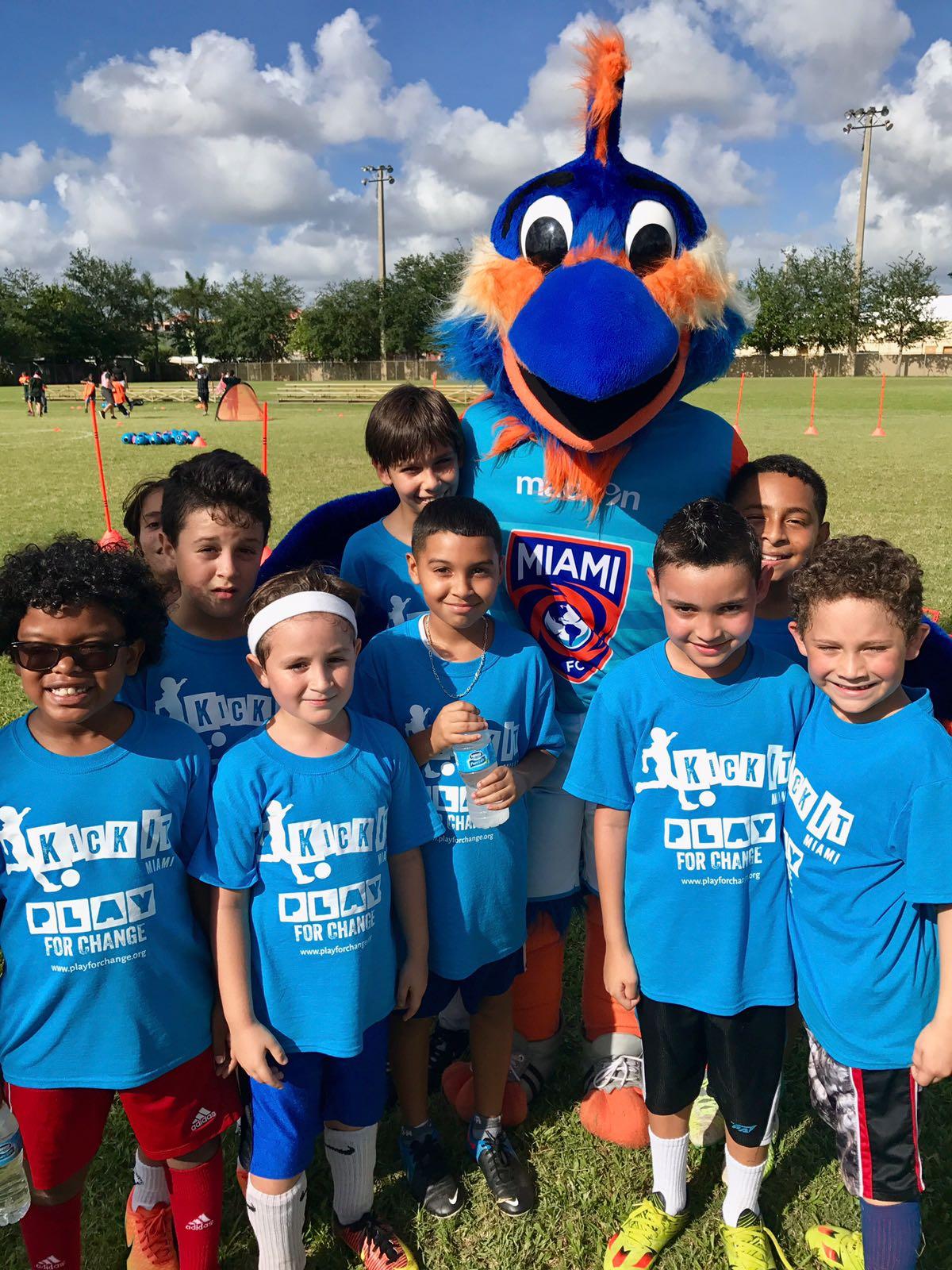 Miami FC mascot with children from Kick It