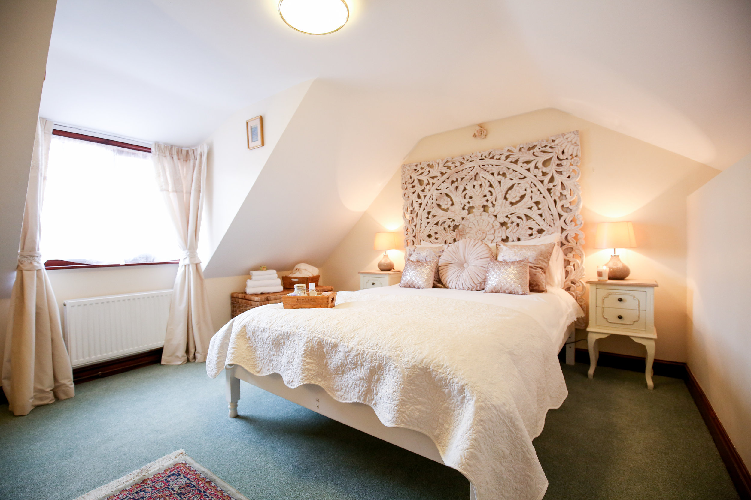 The Dove Loft - The Dove Loft is our signature suite situated in our light, bright attic. With a stunning, carved Moroccan double bed, snug lounge area and contemporary style slipper bath, this dreamy space is the perfect romantic retreat.