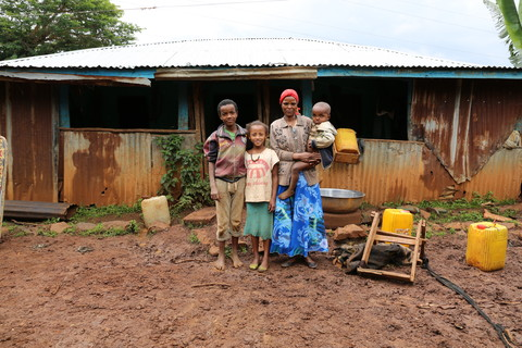 Chaltu and part of her family. Gobena, 12, Mihiretie, 10  and Yohannes, 3. Image by WaterAid/Behailu Shiferaw.