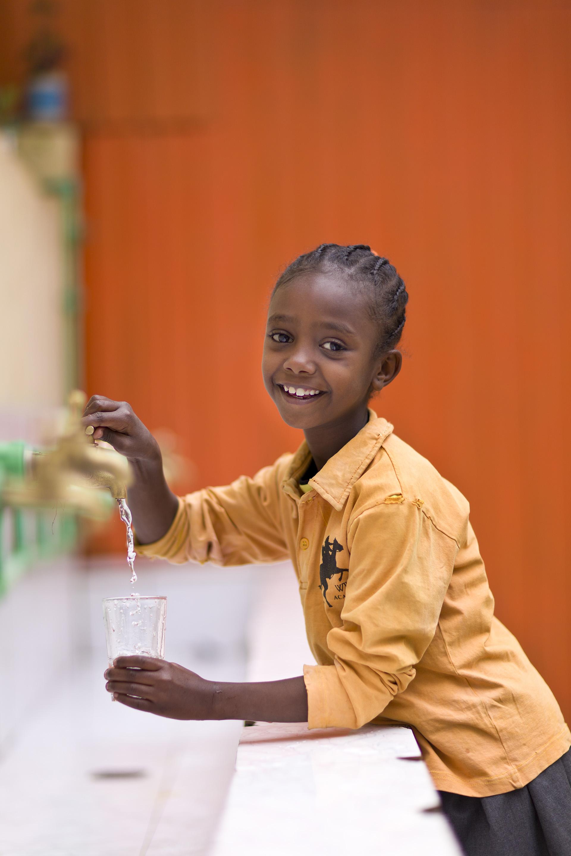 Children in orphanages drinking clean water, Splash