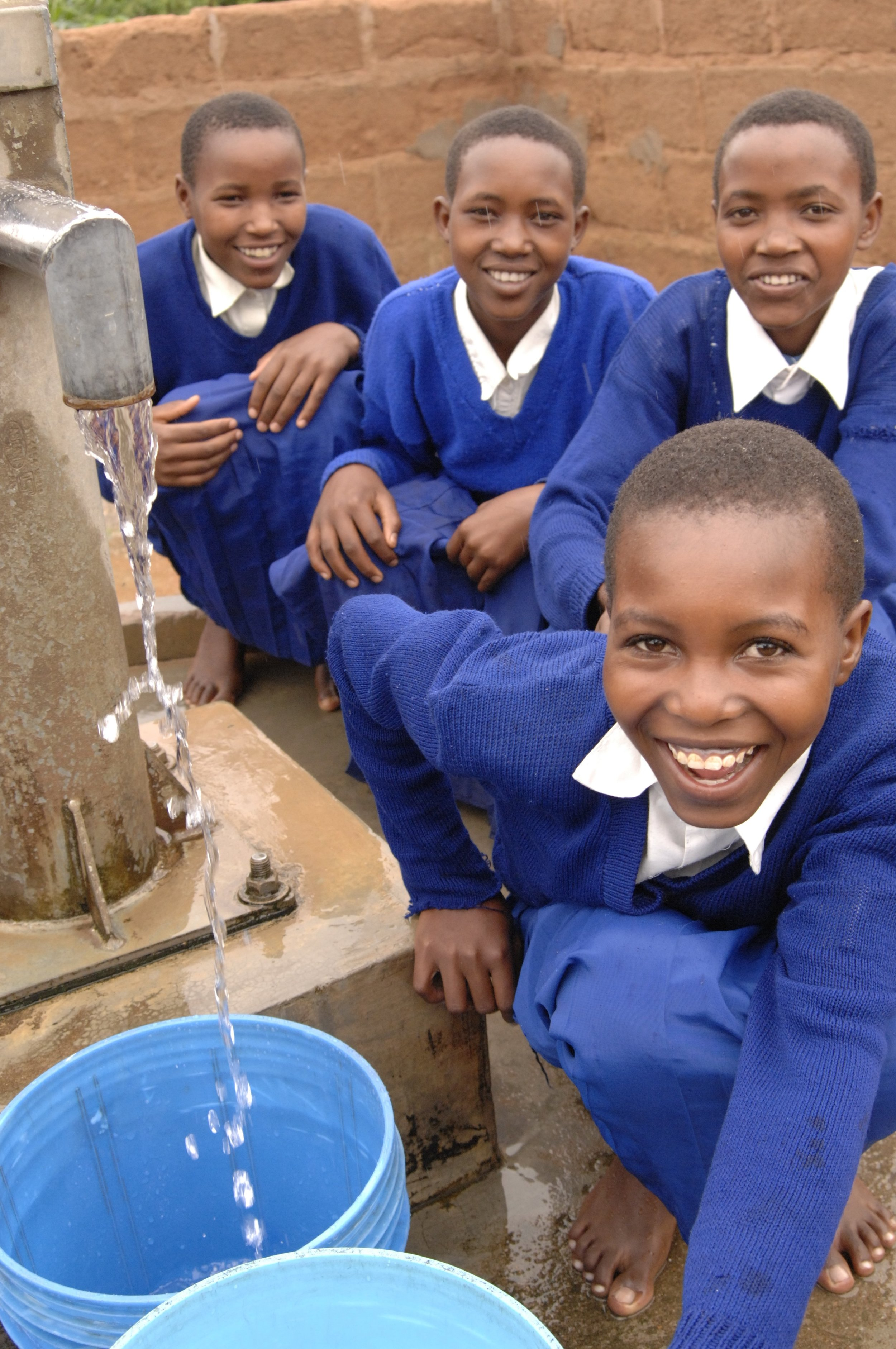"""Mbulu District, Tanzania - Completed in 2014   From the humble beginnings of Project Waterfall, funds raised from UK Coffee Week and The London Coffee Festival from 2011-2014 helped fund this 4 year proejct in the Mbulu district of Tanzania. This project was able to directly change the lives of over 10,000 people, including the Yaeda Chini Primary School.  """"To me, this is a wonder. I did not expect to see this water here in Mongo wa Mono in my lifetime."""" - Yasintha Edward, Secretary of Yaedi Chini COWSO (Community Owned Water and Sanitation Organisation)"""
