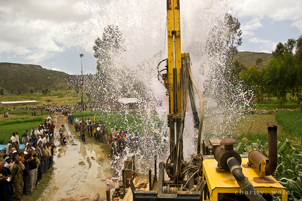 Drilling team accessing water deep beneath the surface. Photo: charity: water