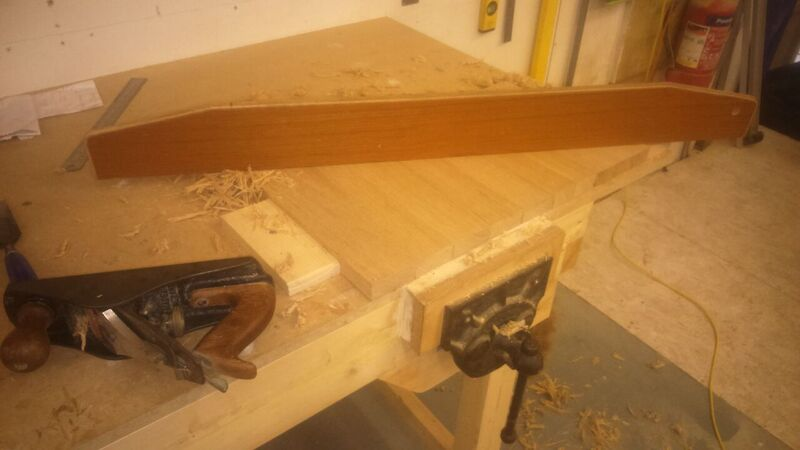 After the glue has cured, I flatten the piece with a smoothing plane