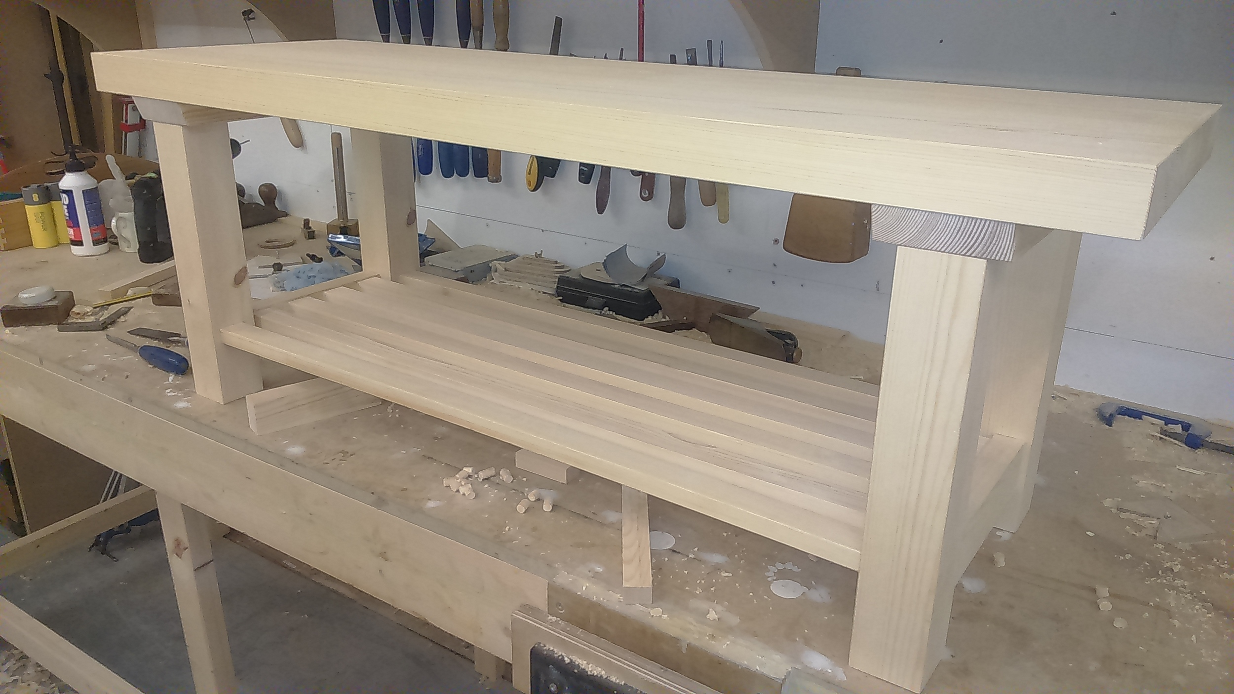 Hallway bench with shoe storage underneath in softwood