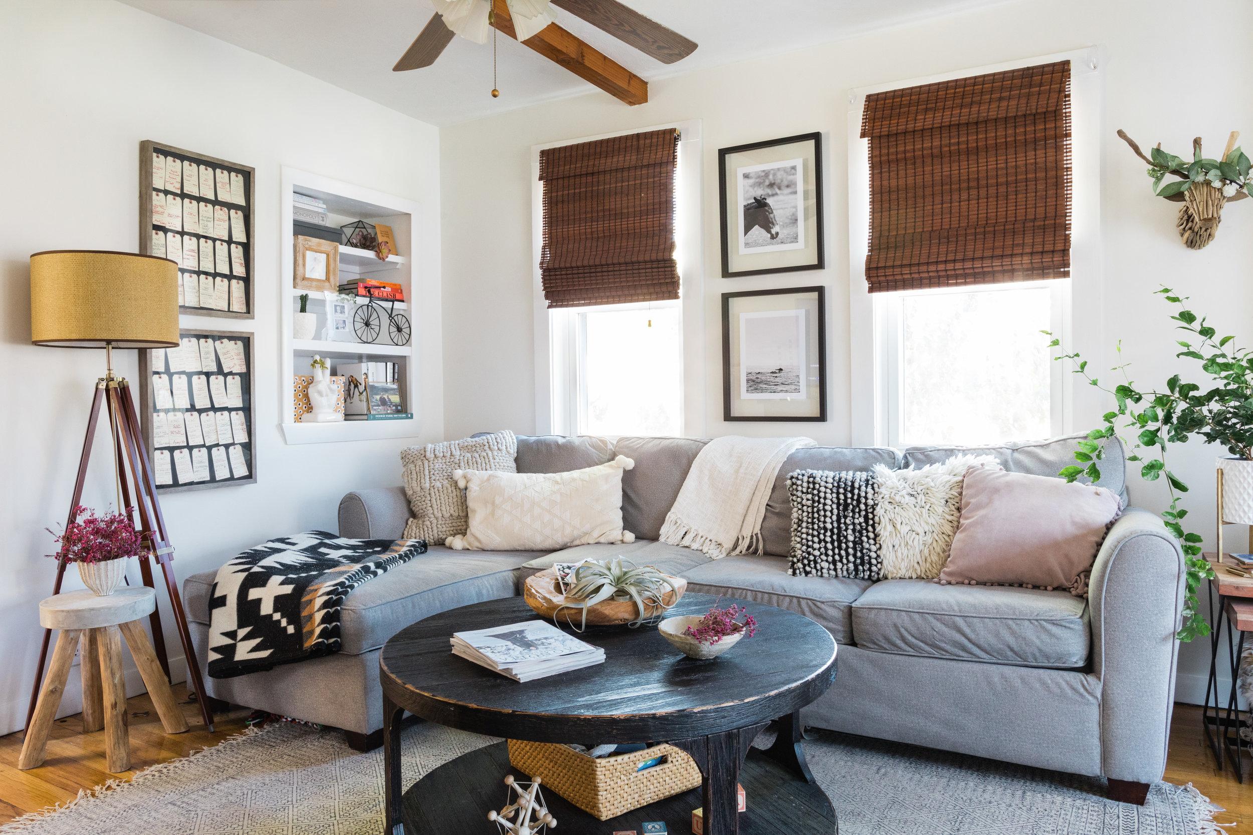 coffee table  /  tripod lamp  / pendleton blanket { similar } / couch { similar } /  rug  / driftwood stag { similar } / driftwood garland { similar } / knit pillow { similar } /  linen throw  / stool { similar }
