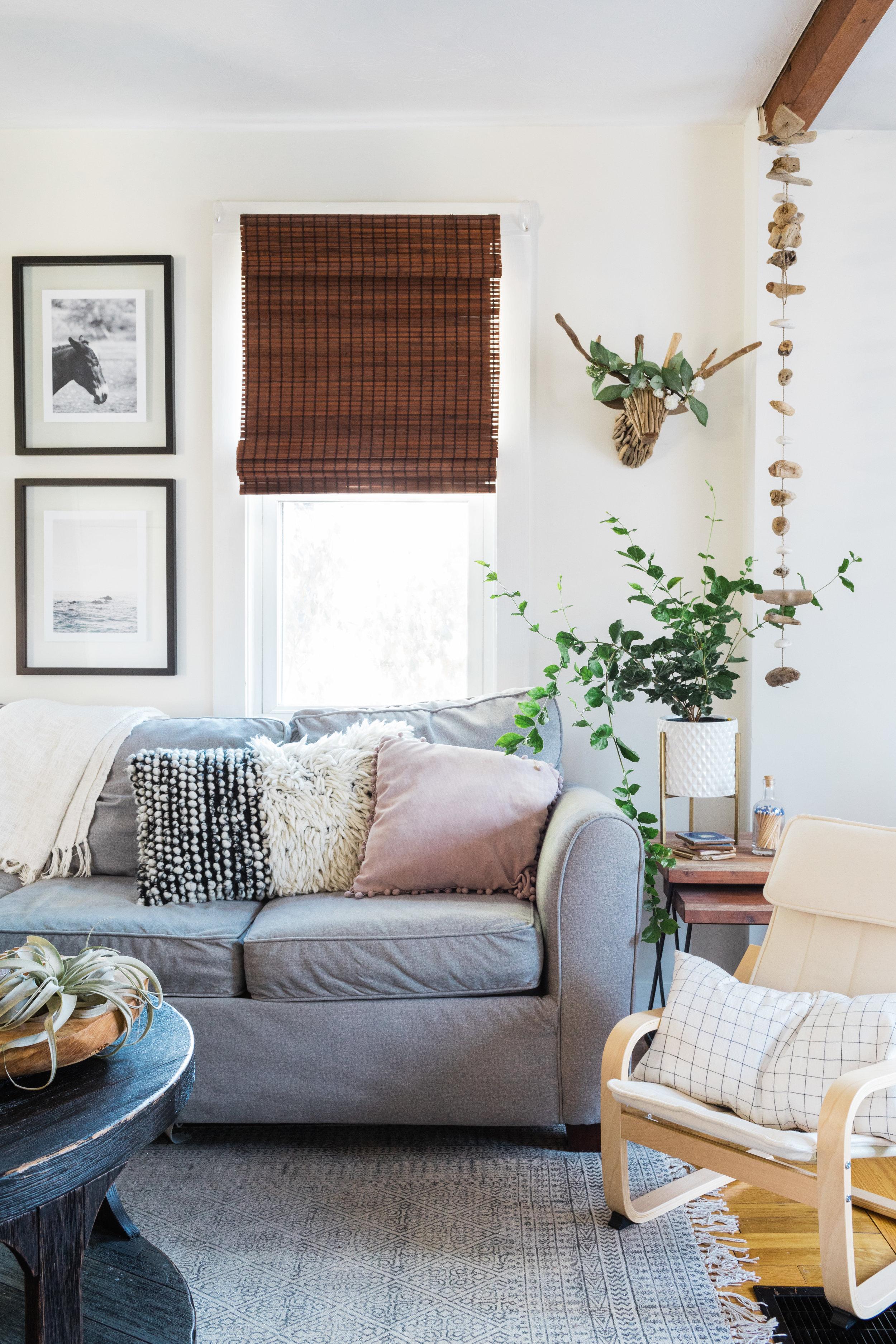 coffee table  /  children's chair  /  windowpane pillow  /  rug  / driftwood stag { similar } / driftwood garland { similar }