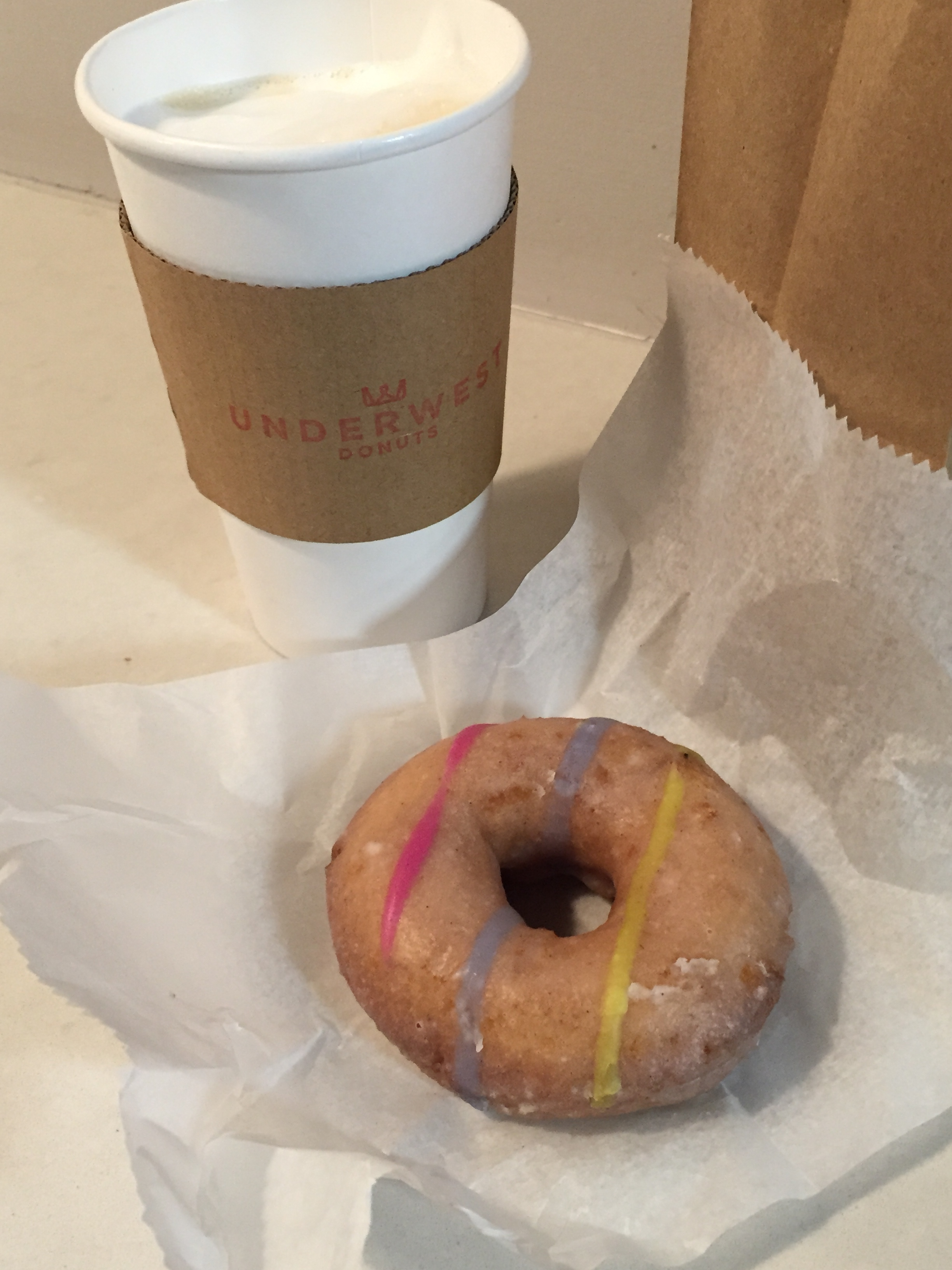 Donut and coffee from  Underwest Donuts --a donut shop literally inside a carwash place. Notice how the frosting looks like carwash soap? Also PS I later spilled that ENTIRE coffee on a bus on the way to work #thatcommutestruggle