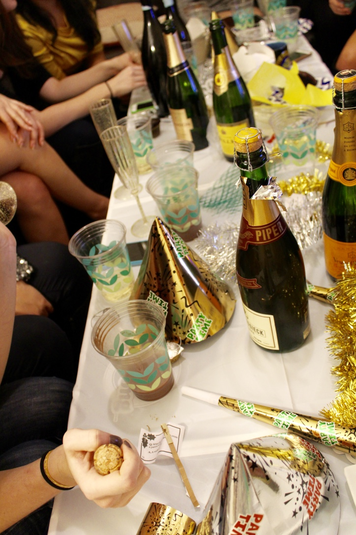 NYE table with the cutest silver and gold decorations.