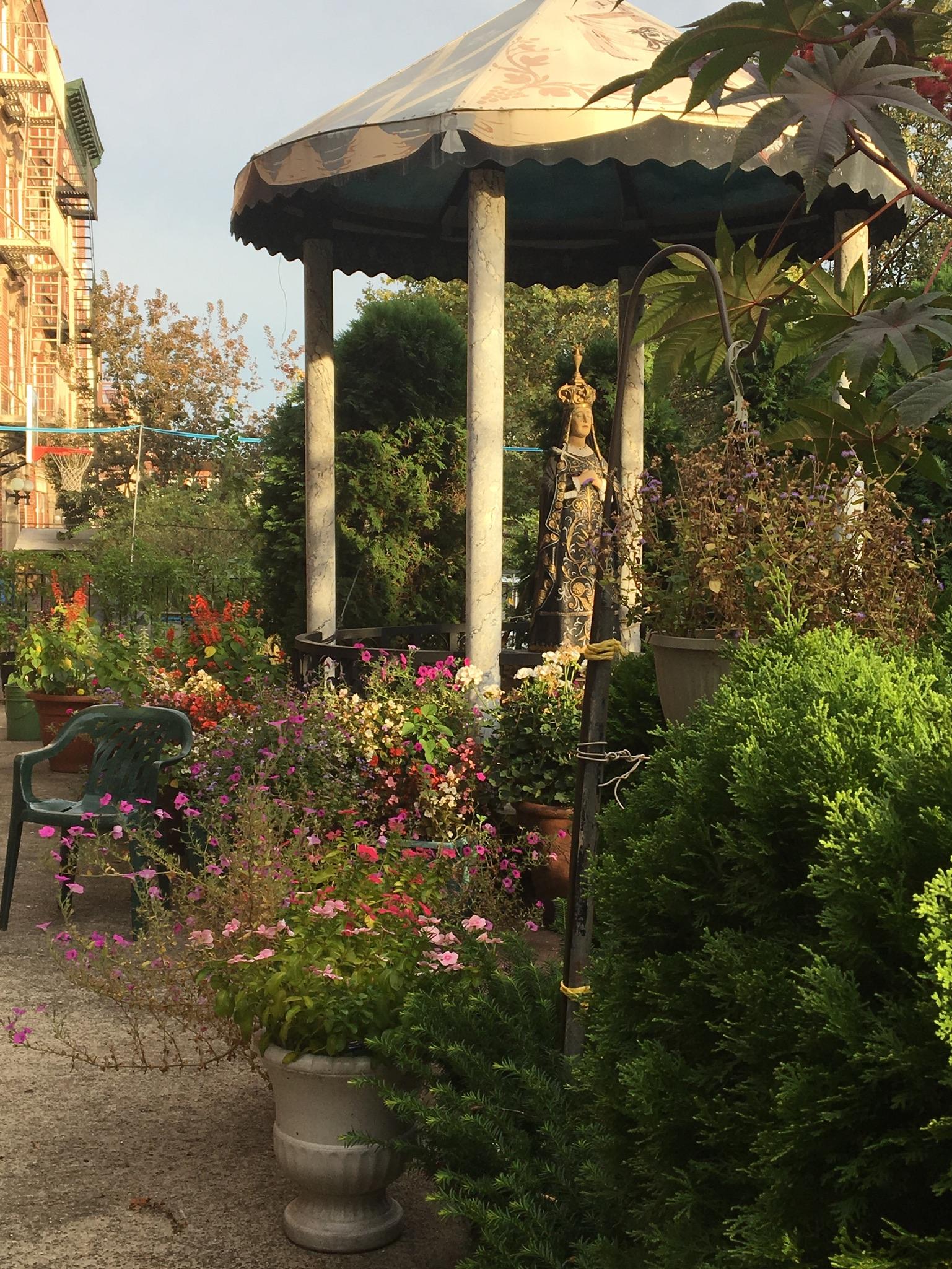 A garden with the Virgin