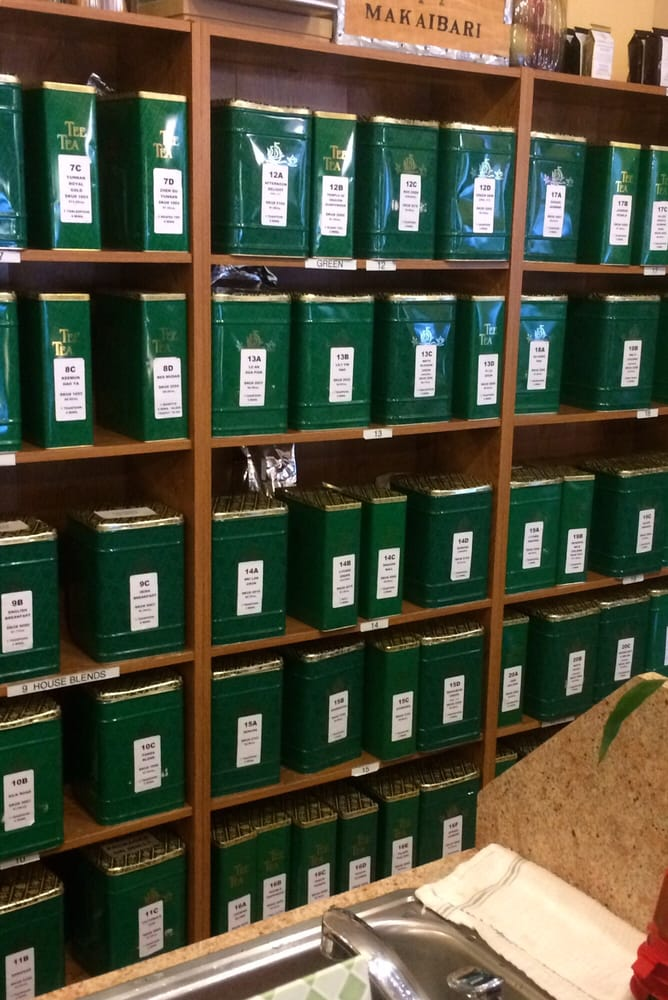 Green tins packed with Silver Tips tea