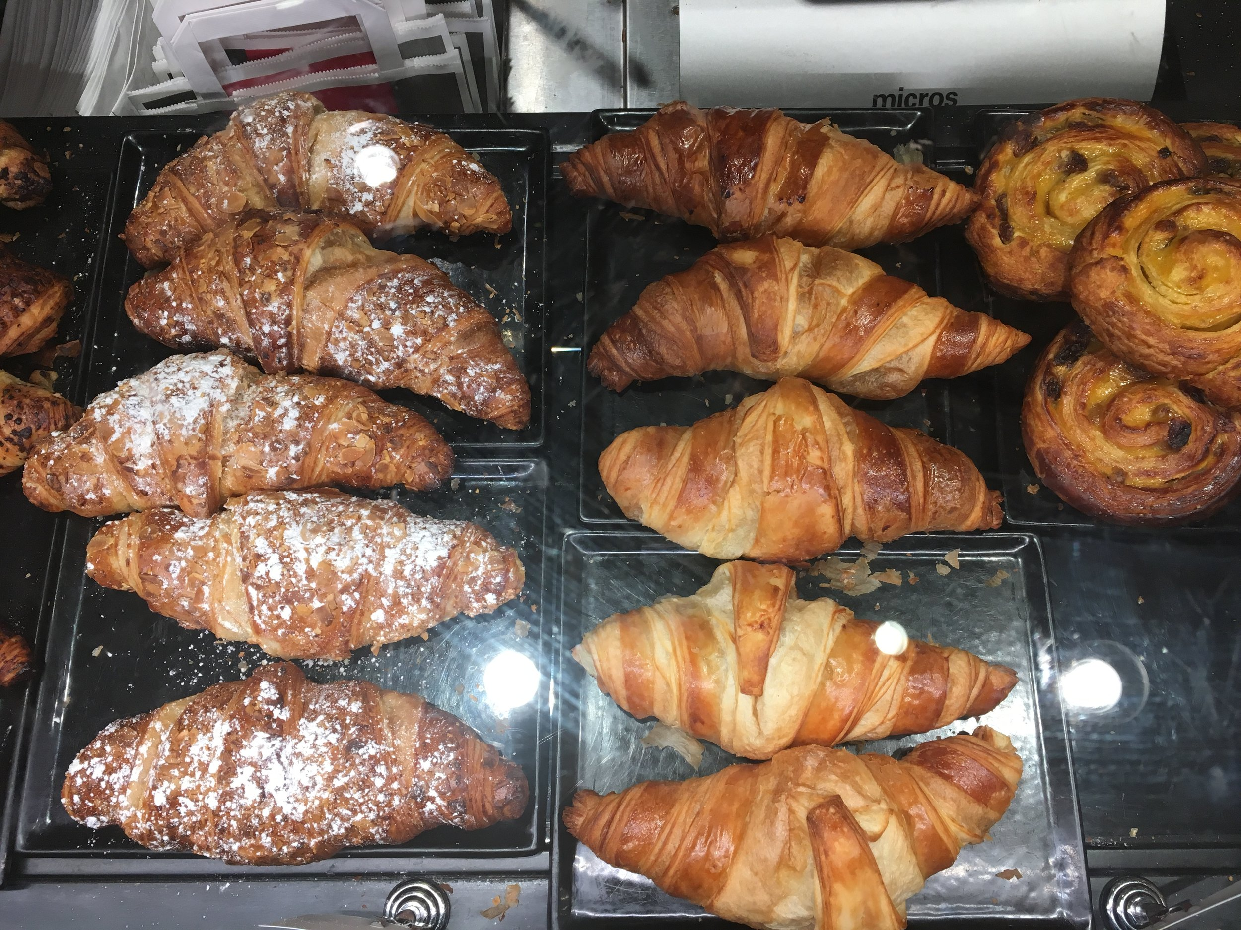 Croissants dusted with sugar and filled with Nutella. Hmmm.