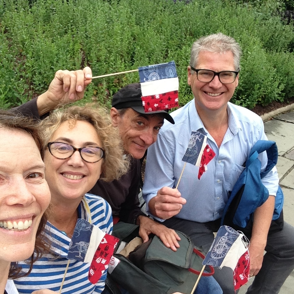 Happy hikers with homemade tricolor