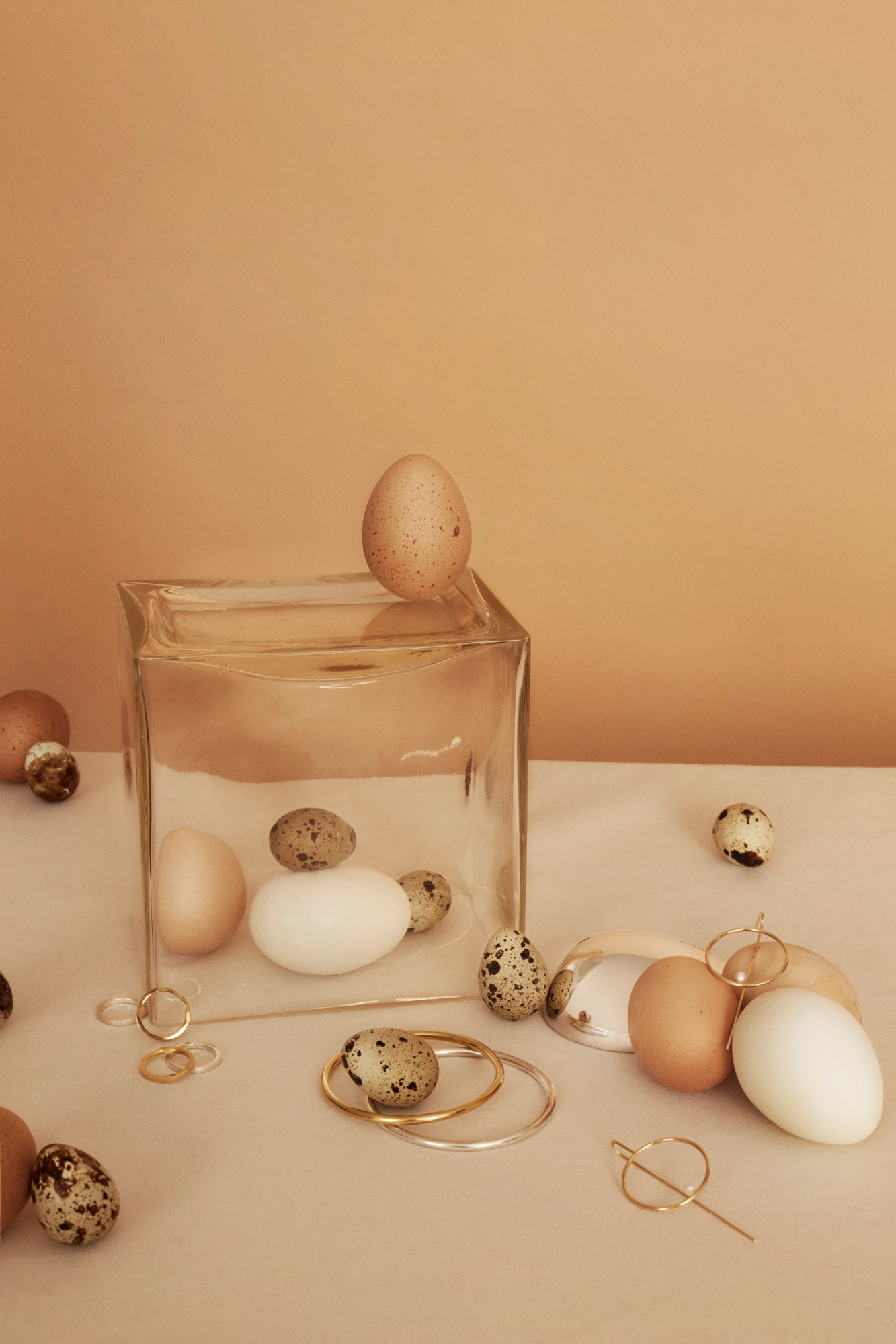 Bracelets in silver and gold Kiki Dieterle Rings in silver and gold and one with a twist Kiki Dieterle  Gold loop pearl earrings TAKK