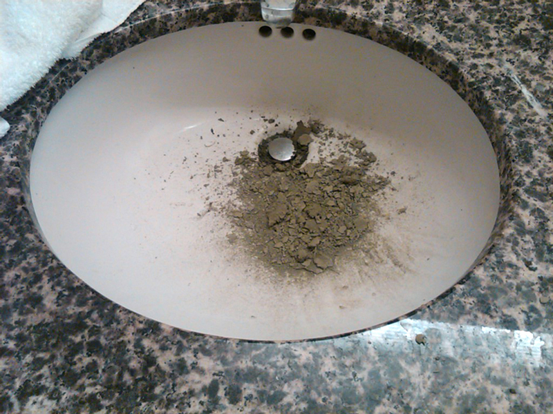 Hotel management sent photos to the museum & said we got cement all over the walls and down the drains.