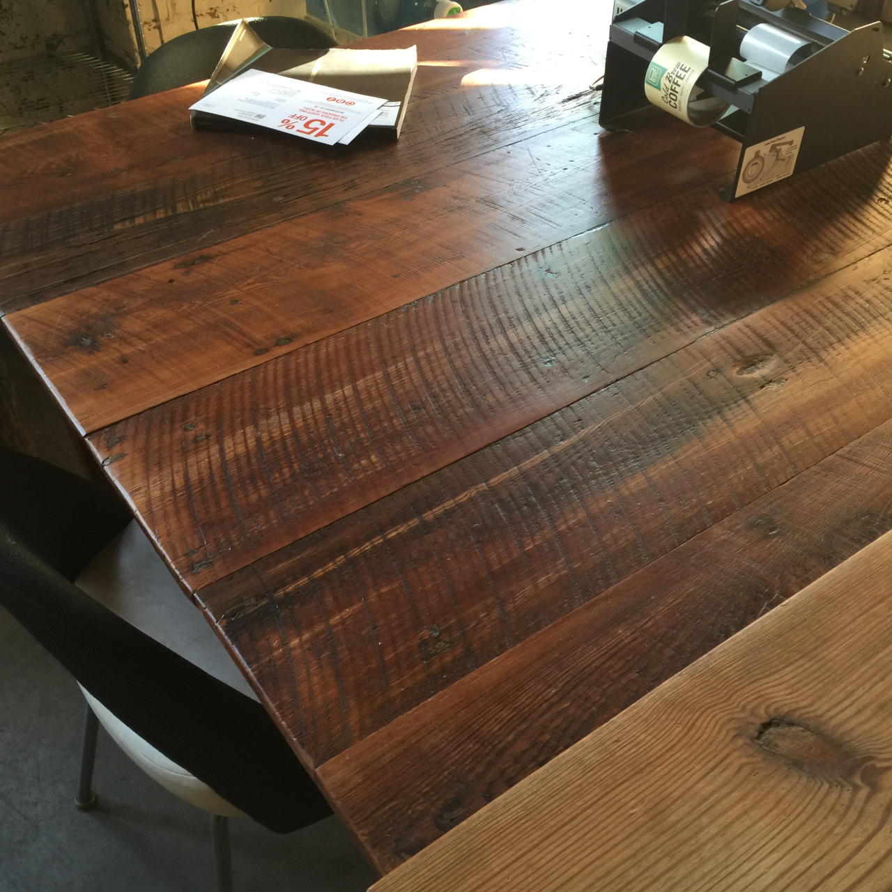 To accent their attention to the journey of their beans, we provided this café table, made of reclaimed heart pine boards we acquired through an extensive deconstruction of the One West Victory building, which used to be an old ice factory. The saw edge markings and old distress is still visible.