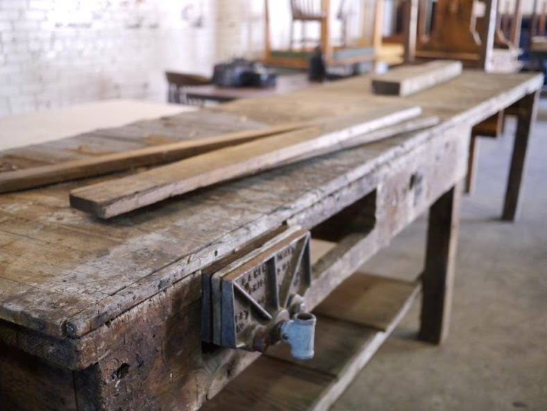 The beautiful reclaimed factory table frame we cleaned up for their espresso bar. Photo courtesy  here .