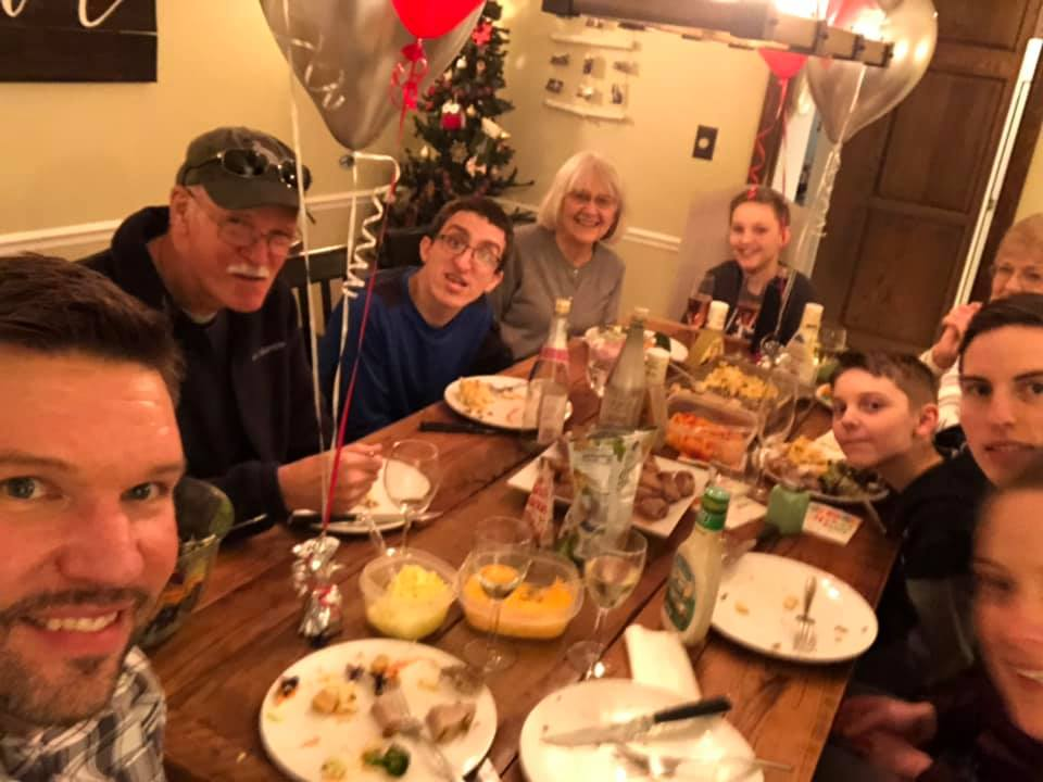 Theo sitting between John and Jan with Jeremy and Cortney and family, Christmas time 2018