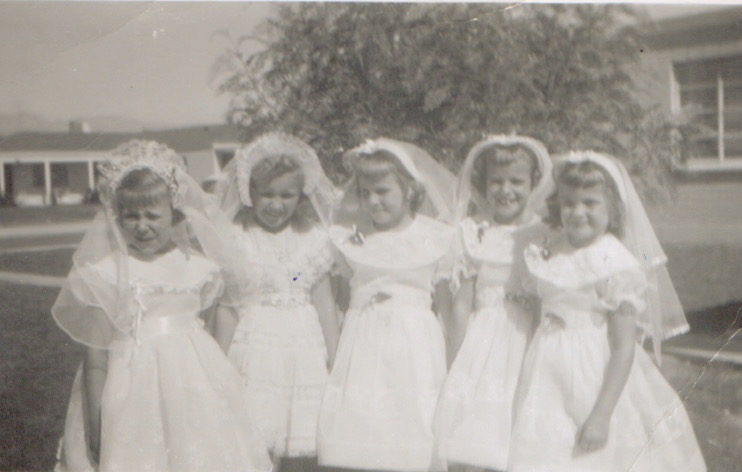 Monica far left, me to her right with other girlfriends at our First Communion in Tucson