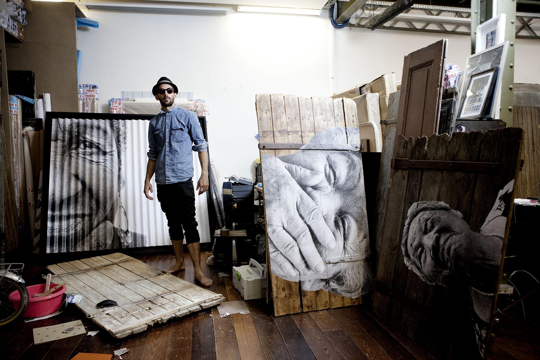 JR in his Paris studio
