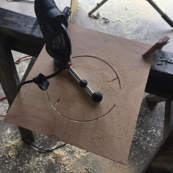 Cutting out the speaker opening with my rotozip saw.
