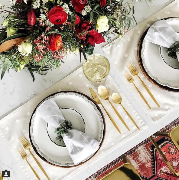 """""""When @witanddelight_ decorates her studio kitchen for guests, the result is festive and chic with luxe gold accents. // Featured Design: Swanbridge™ #holidaysathome #cambriaquartz"""""""