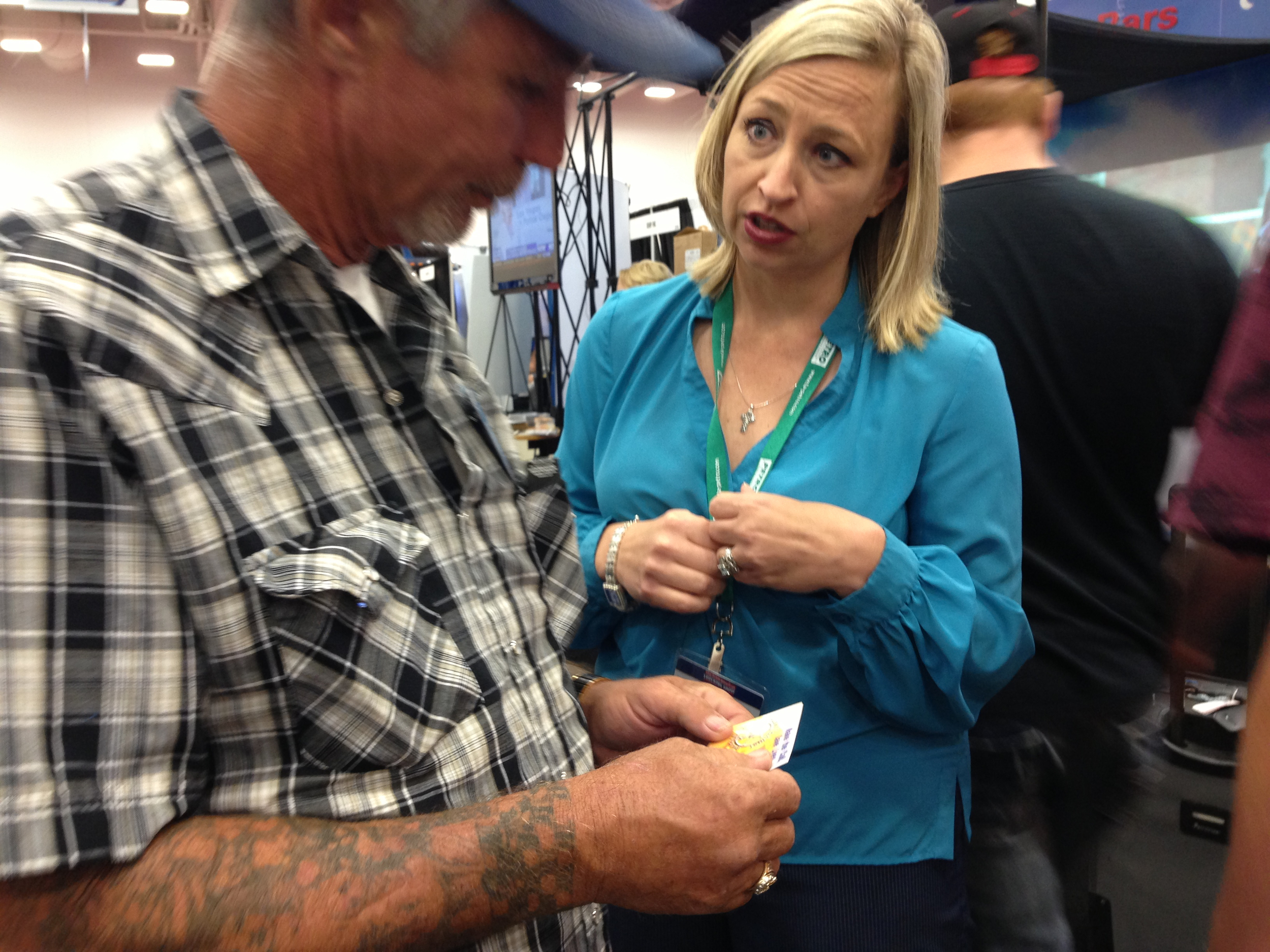 Kylla handing out wallet cards at the Great American Trucking Show in Dallas