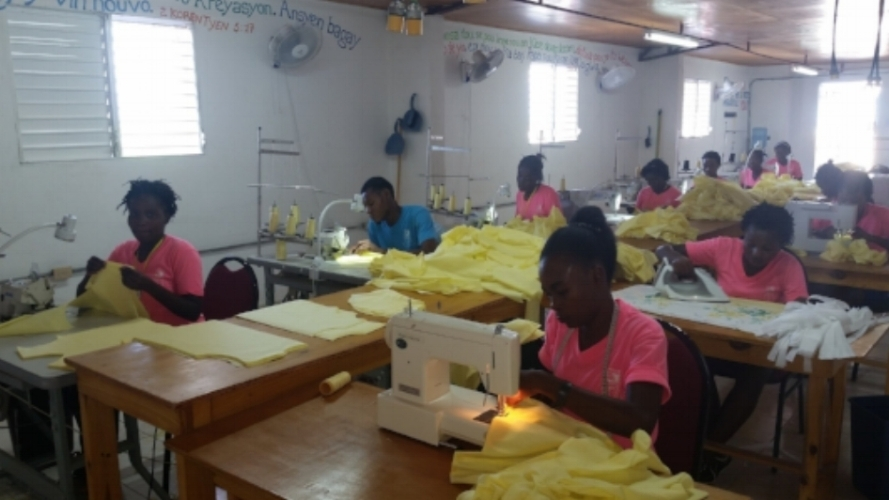 Students from the current class making uniforms.