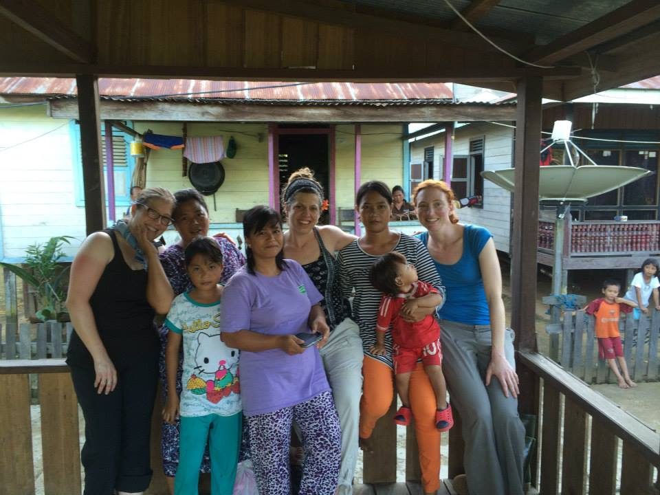Katie and two other US visitors with locals from Merabu Village