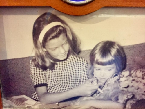 My sister (left) and I (right) playing nurse when we were kids