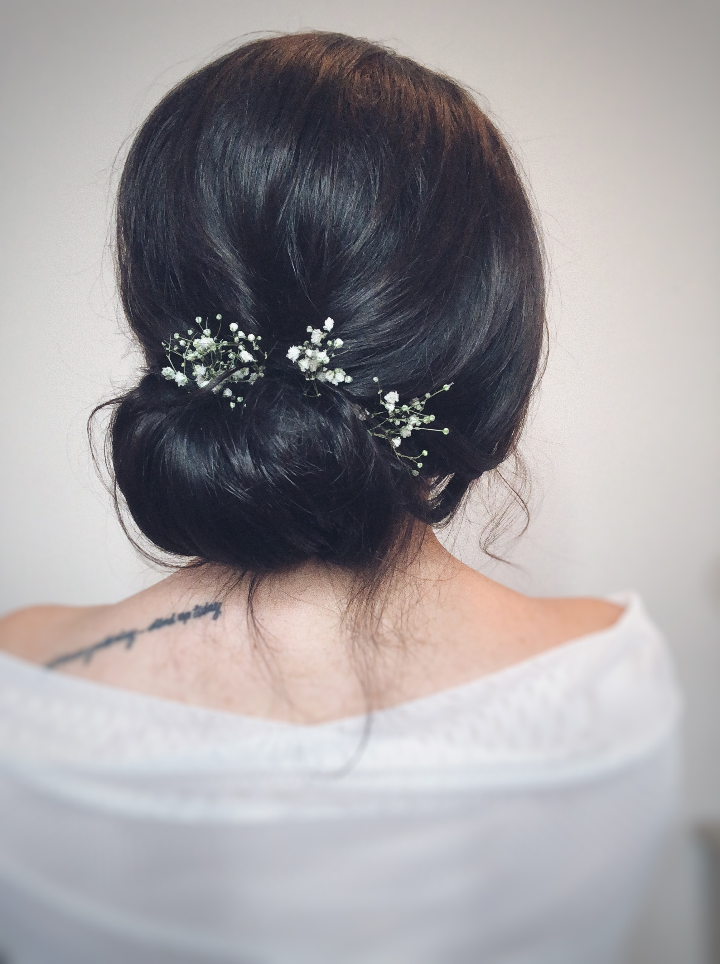 low bun wedding hairstyle updo idea with babysbreath