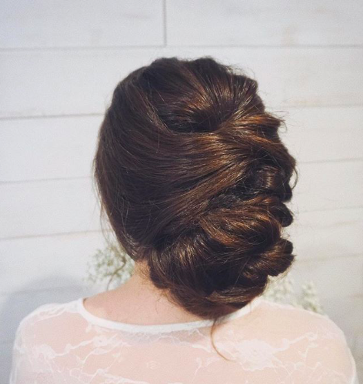 Smooth low bun in back