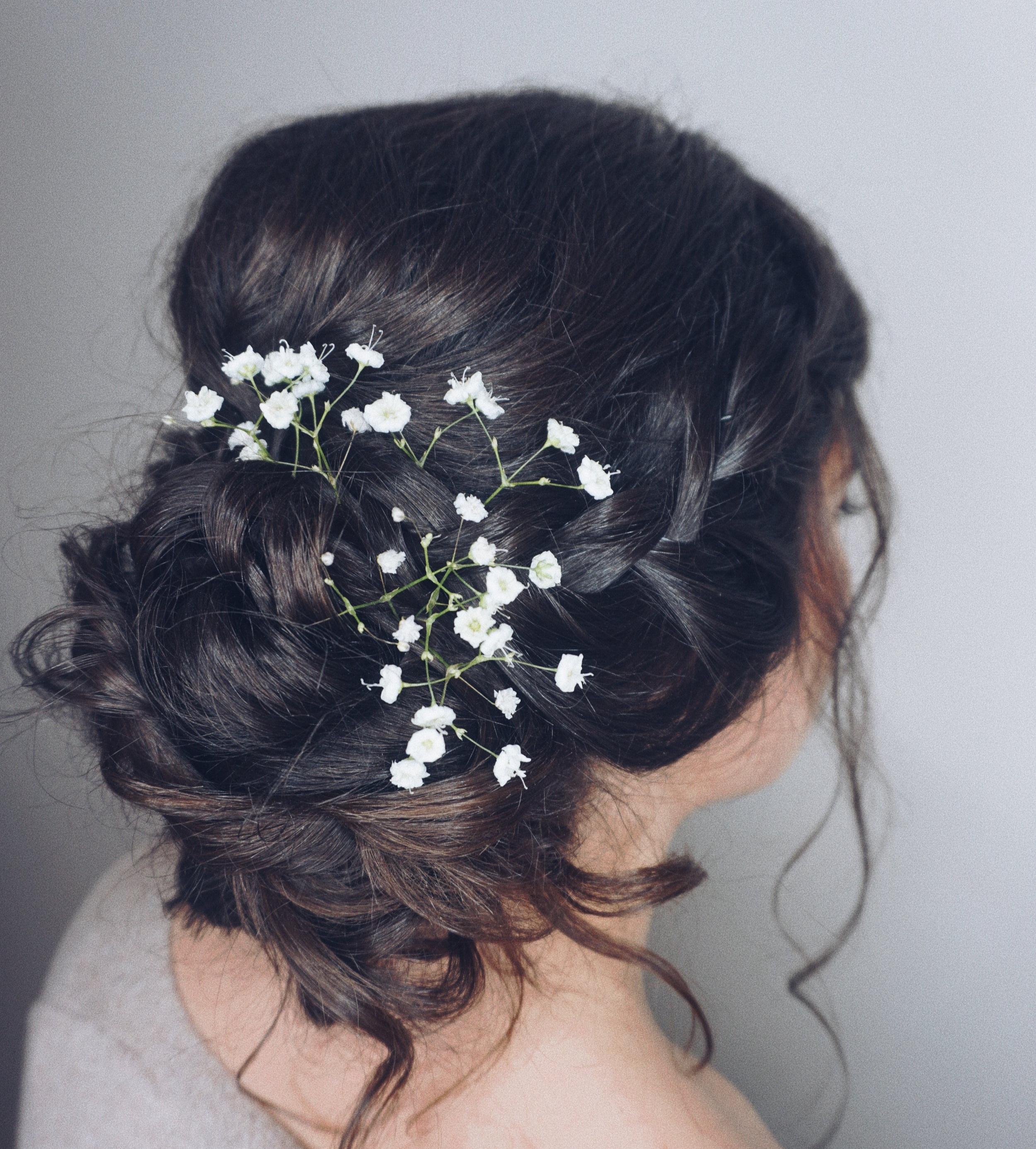 Textured side low bun with braids & florals