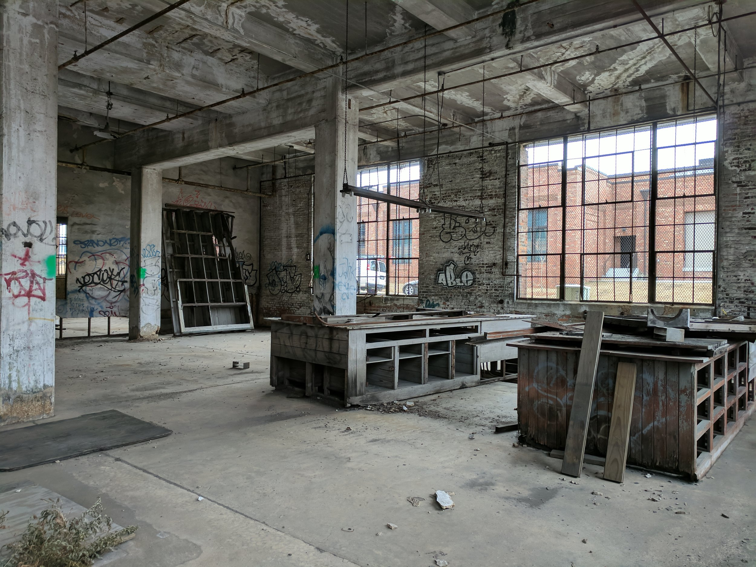 Interior photograph of workshop space that existed previously within the Central of Georgia Railway building. When designing a proposal for a revitalization of this space, it was important to our team to give homage to the history of the building and preserve the legacy that was created in this historic building.