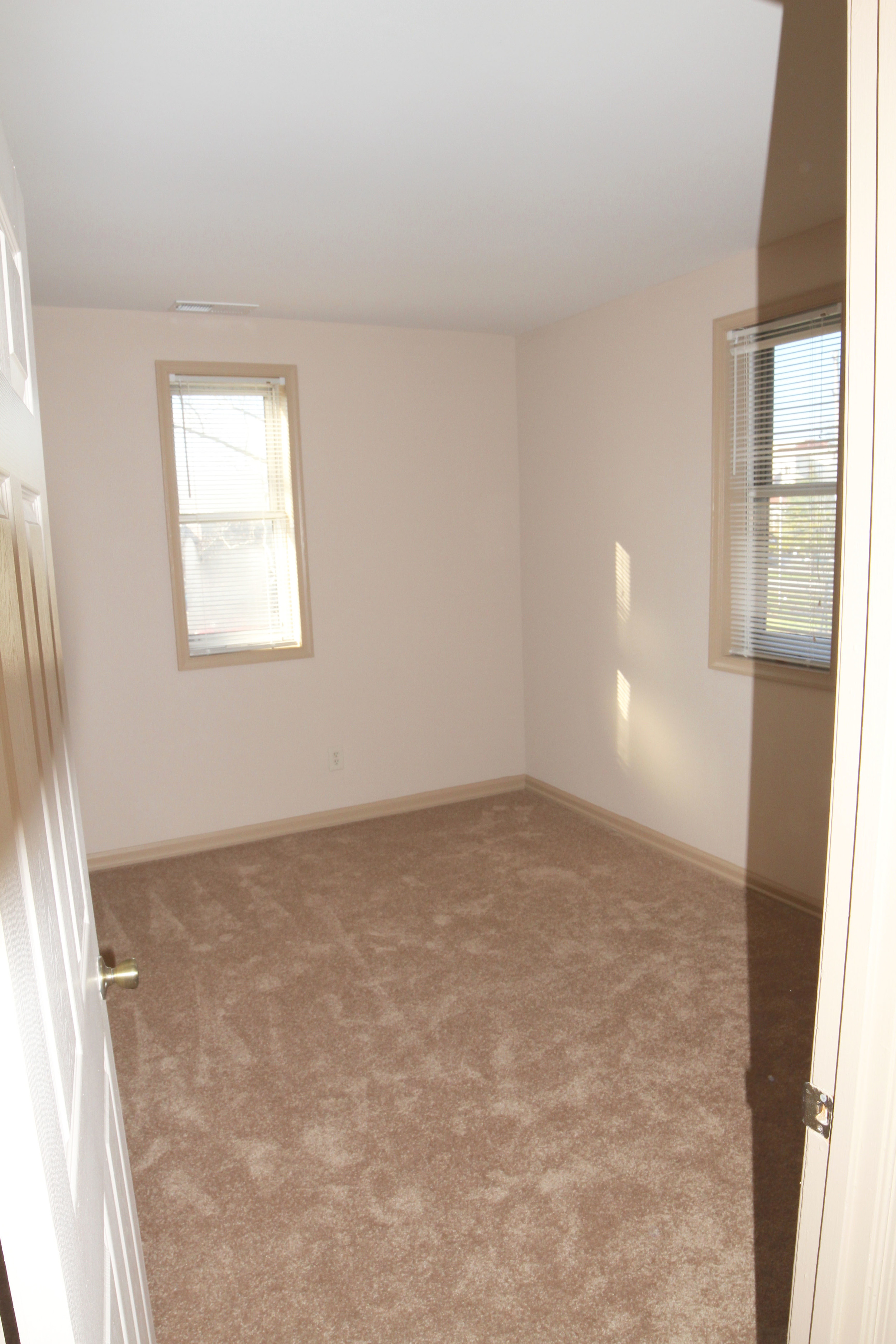 The smaller bedroom is a great size, with two windows and plenty of closet space!