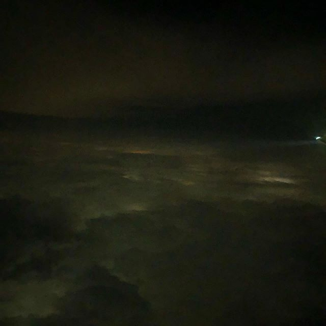 Lightning on a night flight above the clouds.