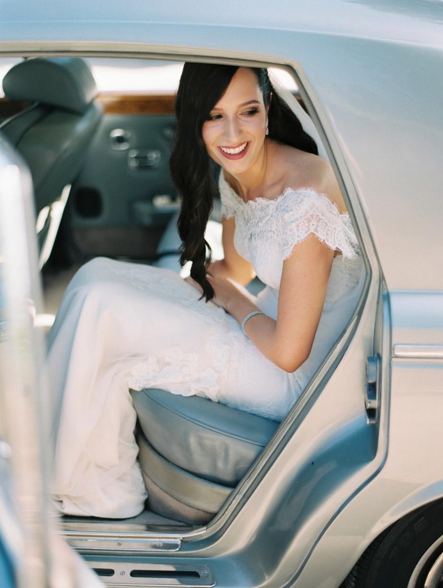 Bride wearing Greta Kate arriving in car at Glen Ewin Estate wedding by film photographer Bentinmarcs